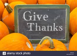 give thanks thanksgiving concept words in white chalk on a stock