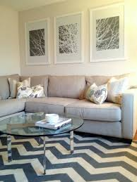 White And Gray Rugs Sweet White Wooden Frames Artwork Portray At White Wall Painted