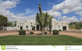 usa arizona phoenix pueblo revival adobe house saguaro front
