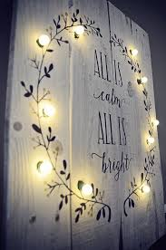 this painted all is calm all is bright sign with lighted
