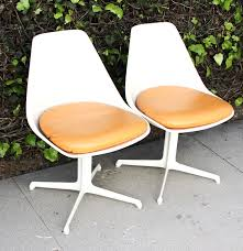 pair of mid century modern eames style bucket chairs ebth