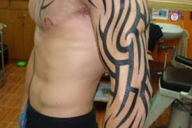 arm and chest tribal tattoos