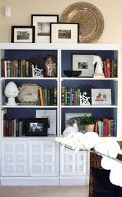 how to style a bookcase steven and chris ideas about decorating a