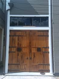 garage doors custom new orleans historic carriage house doors with dark bronze