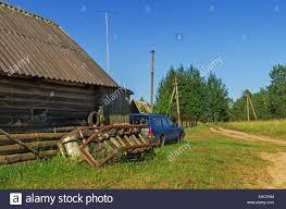 horse sledge barn car and green grass yard stock photo royalty