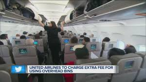 united airlines charge extra fee for using overhead bins youtube