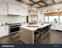 kitchen interior island sink cabinets hardwood stock photo kitchen interior with island sink cabinets and hardwood floors in new luxury home
