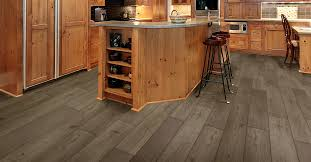 kitchen cabinets on top of floating floor baudiers floors laminate flooring sales and installation