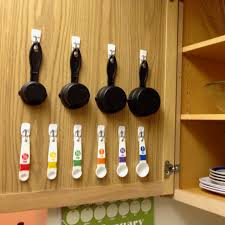 Measuring Cabinet Doors Friday Favorite Creative Uses For Command Hooks Measuring Cup