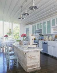 shabby chic kitchen island like the ceiling lights in this farmhouse kitchen originally from