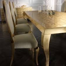 alligator embossed leather chairs and gold leaf dining table set