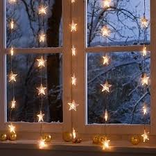light up window decorations starry window this one shows 5 separate strands not connected at