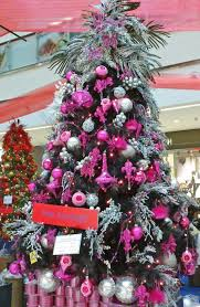 white tree with pink and silver decorations