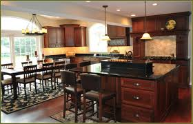 cherry wood kitchen cabinets with black granite