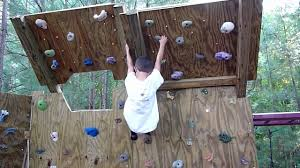 5 year old climber on the new backyard climbing wall overhang