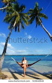 young woman sitting hammock between stock photo 514032757