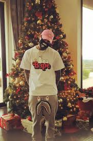 chris brown chills in front of christmas tree in bape t shirt