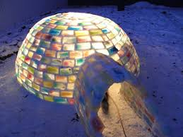 man builds amazing igloo using frozen milk cartons