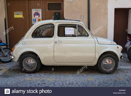an old fiat 500 cinquecento car for sale on a street in cefalu