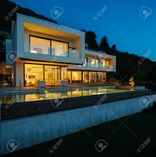 modern house with pool and garden summer time stock photo