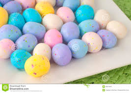 easter candy eggs easter egg candy in a square white dish on a table closeup