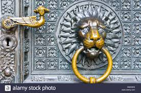 ornate decorative lion head door knocker on cologne cathedral