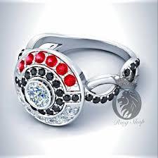 pokeball engagement ring pokeball ruby black and white diamonds infinity band