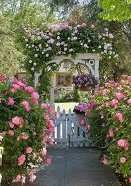 Old English Garden Design With White Picket Fence And Trellis