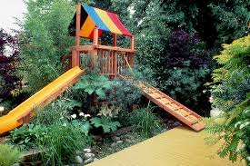 treehouse for kids with sliding board colorful yellow painted