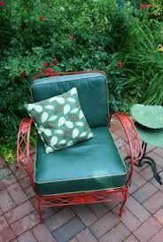 vintage red metal patio chair with green accents pull up a seat