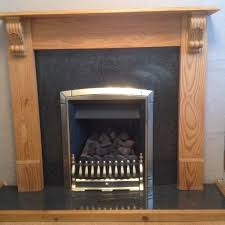 coal effect gas fire and fireplace surround with hearth in