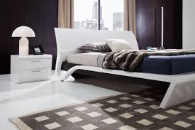 trendy platform bed frame design and white lacquer nightstand with
