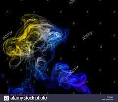 halloween color background abstract art color yellow blue smoke from the aromatic sticks on