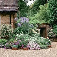 garden design ideas for grassless spaces ideal home