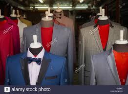 selective focus men u0027s suit on mannequin in front of dress room