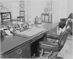 file photograph of president truman u0027s desk and chair in the oval