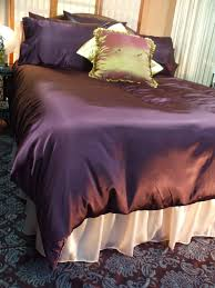 satin bed linen between the sheets