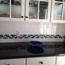 tile borders for kitchen backsplash glass tile border on backsplash uba tuba granite i like this