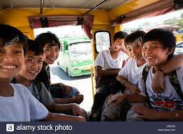 philippines jeepney inside filipino boys riding a jeepney on their way home from stock