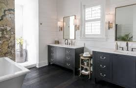 black bathroom vanity with gold mirrors transitional bathroom