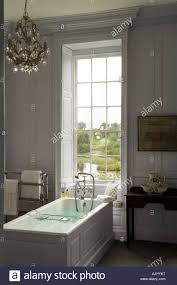 panelled walls bathroom with wood panelled walls and chandelier in irish castle