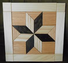 a lovely quilt design made from wood wall hanging this would be