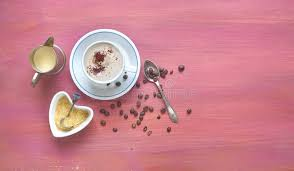 Salep Pink cup of cappuccino coffee sugar milk and coffee beans stock image