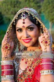 traditional dress up of indian weddings beautiful indian in traditional wedding dress and posing
