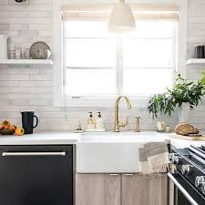 farmhouse kitchen with oak cabinets gray oak cabinets with farmhouse sink and brass faucet