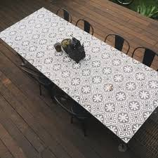 custom moroccan tiled table with plumbing piped legs made by