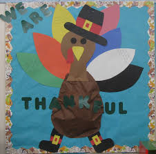 thanksgiving bulletin board with we are thankful feathers belly