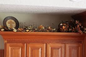 how to decorate above kitchen cabinets for fall fall decor kitchen cabinets decor decorating above