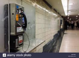 hallways public pay phone in one of the hallways of subway station at stock