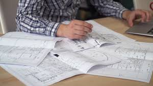 young professional designer checking architectural sketch at the